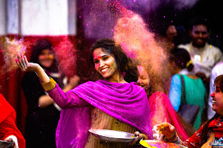 Holi, cute girl celebrating, jovial, distributing happiness, festival of colours