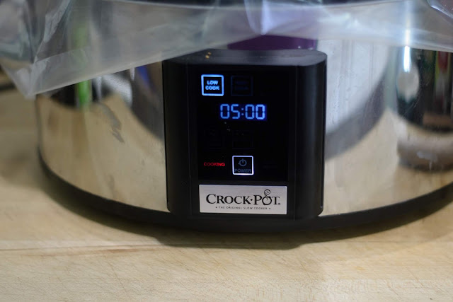 The slow cooker set to low with a 5 hour timer.