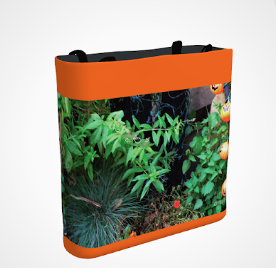 "This screen-shot features an orange tote/bag/pouch which has an image imprinted on it. The picture was taken in my garden when decorated for Halloween. It shows four little pumpkin outdoor lights amongst the flora. The tote is available in three sizes (13"" by 13"", 16"" by 16"" and 18"" by 18"") and can be purchased via Fine Art America @ https://fineartamerica.com/featured/four-little-pumpkins-patricia-youngquist.html?product=tote-bag"