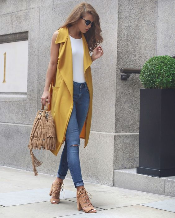 Nada Adelle - Yellow Sleeveless Duster Coat + Blue Jeans + Nude Lace Up Heels