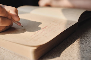 A hand writing in Journal