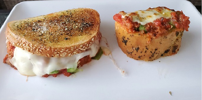 these are Italian style sloppy joe's one with grilled mozzarella the other open faced both on Italian bread