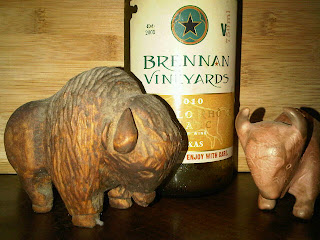 bottle of wine with carved buffalos