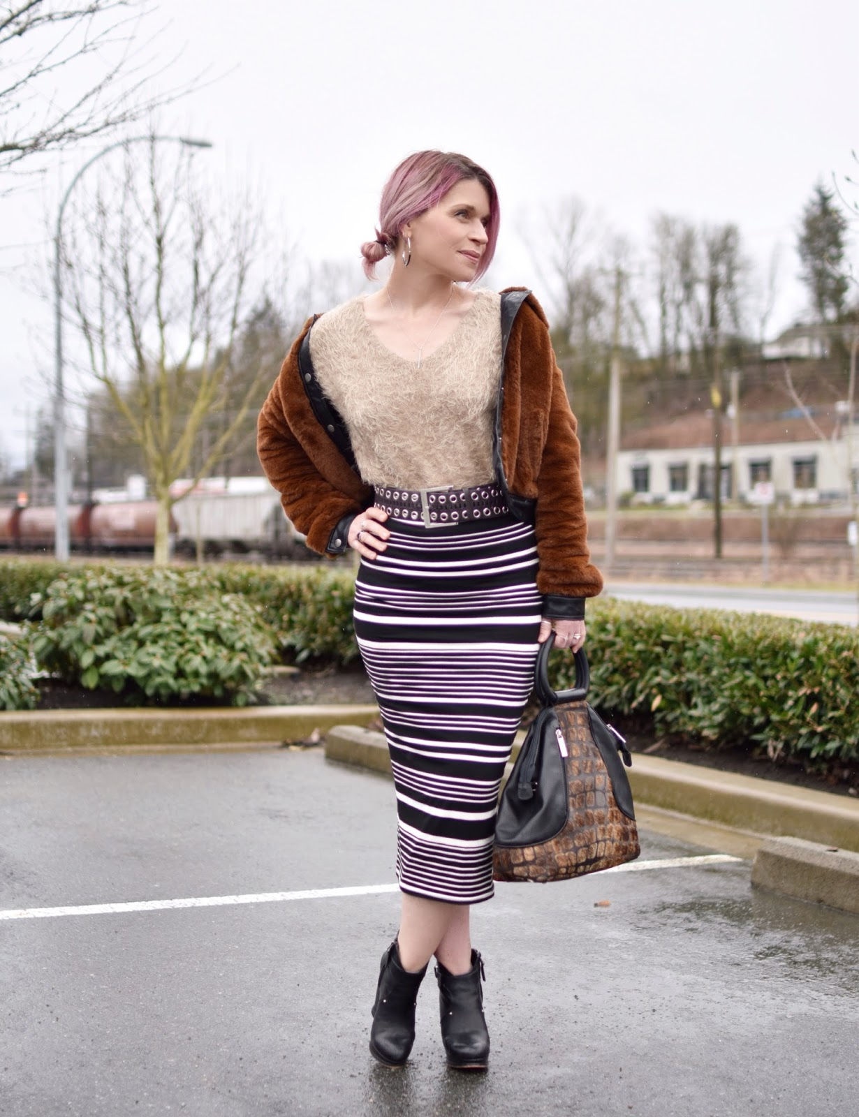 Monika Faulkner outfit inspiration - styling a striped midi-length pencil skirt with wedge booties and a furry bomber jacket