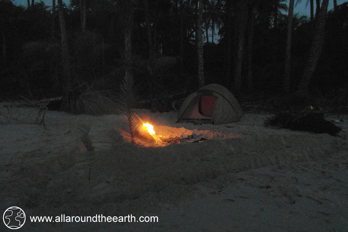 Protecting tent from tides with dams while camping on the beach of Bubaque Island, Bijagos Archipelago, Guinea Bissau, West Africa