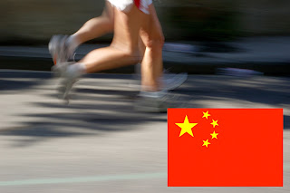 Photo of runners with Chinese flag