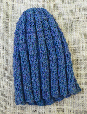 A reversible wool textured hat for sale at https://www.etsy.com/shop/jeanniegrayknits