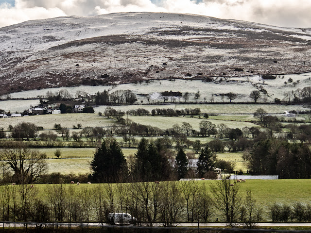 Photo of the A66 Workington to Keswick road with snow on the hills beyond