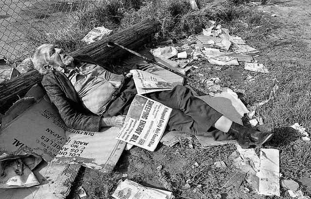 a Daniel Teoli Jr. photograph 1972, a homeless man asleep