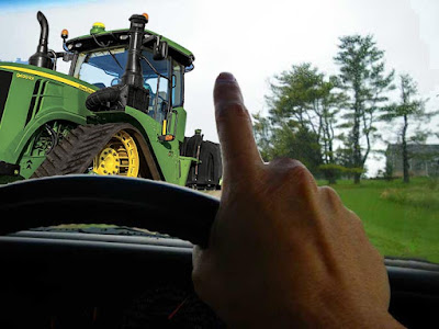 John Deere tractor and 1-finger wave