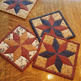 Lemoyne Star mug rugs: QuiltBee