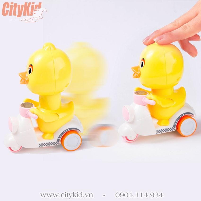 Vịt đồ chơi chạy xe máy vespa