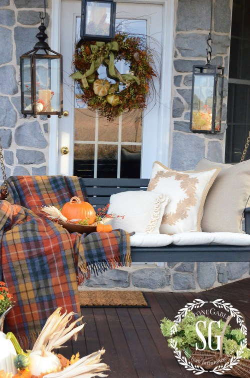 Fall decorated porch swing
