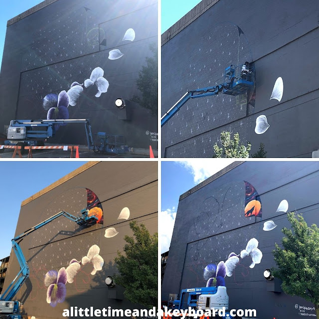Artist Jeff Henriquez in action creating a stunning  new  mural in Janesville.