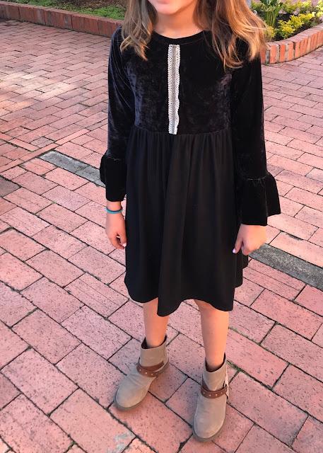 Girls' DIY black velvet bell sleeve dress from a free pattern.