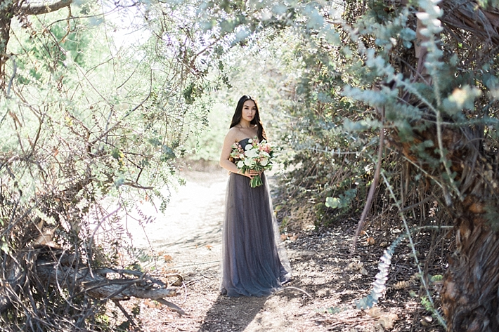Bride in Grey BHLDN Gown with lush bouquet