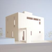親密な光の気配を内に持つくっきりとした外観の家