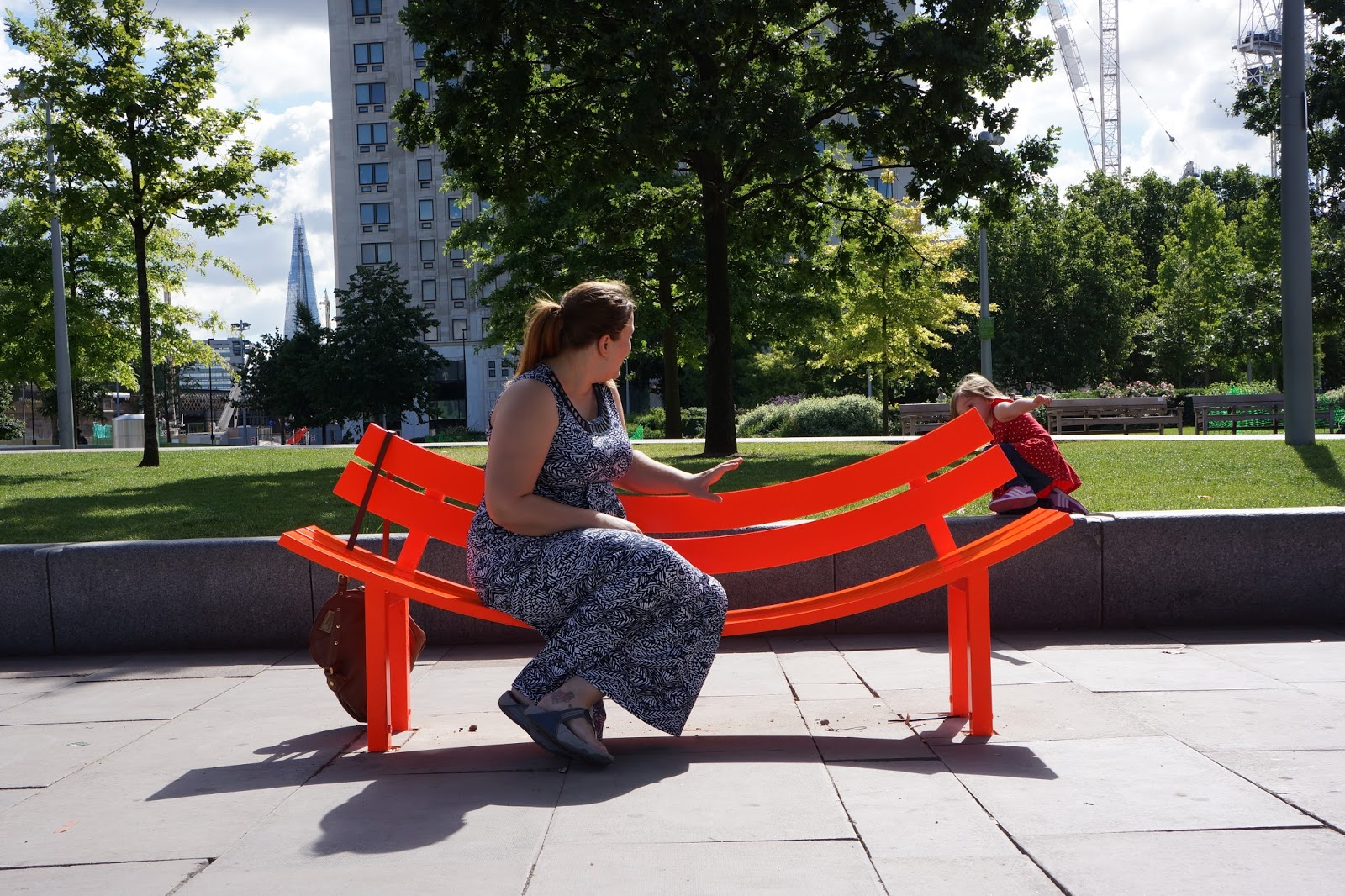 sitting on an artsy bench at south bank