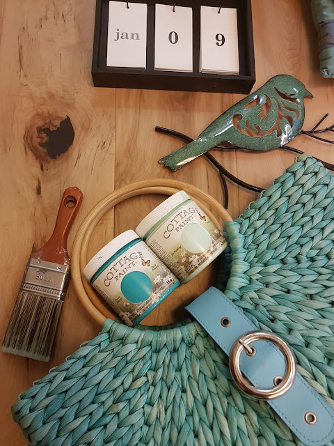 Cottage Paint near turquoise beach bag at The Camellia