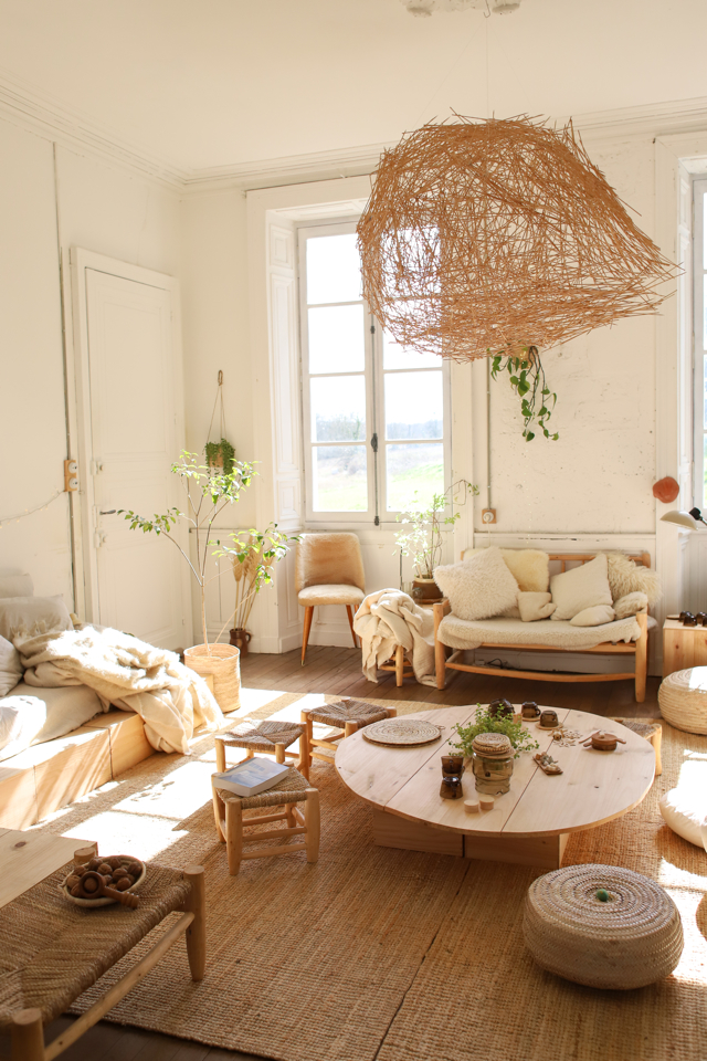 Such a magical living room awash in natural light and adorned with plants- design addict mom