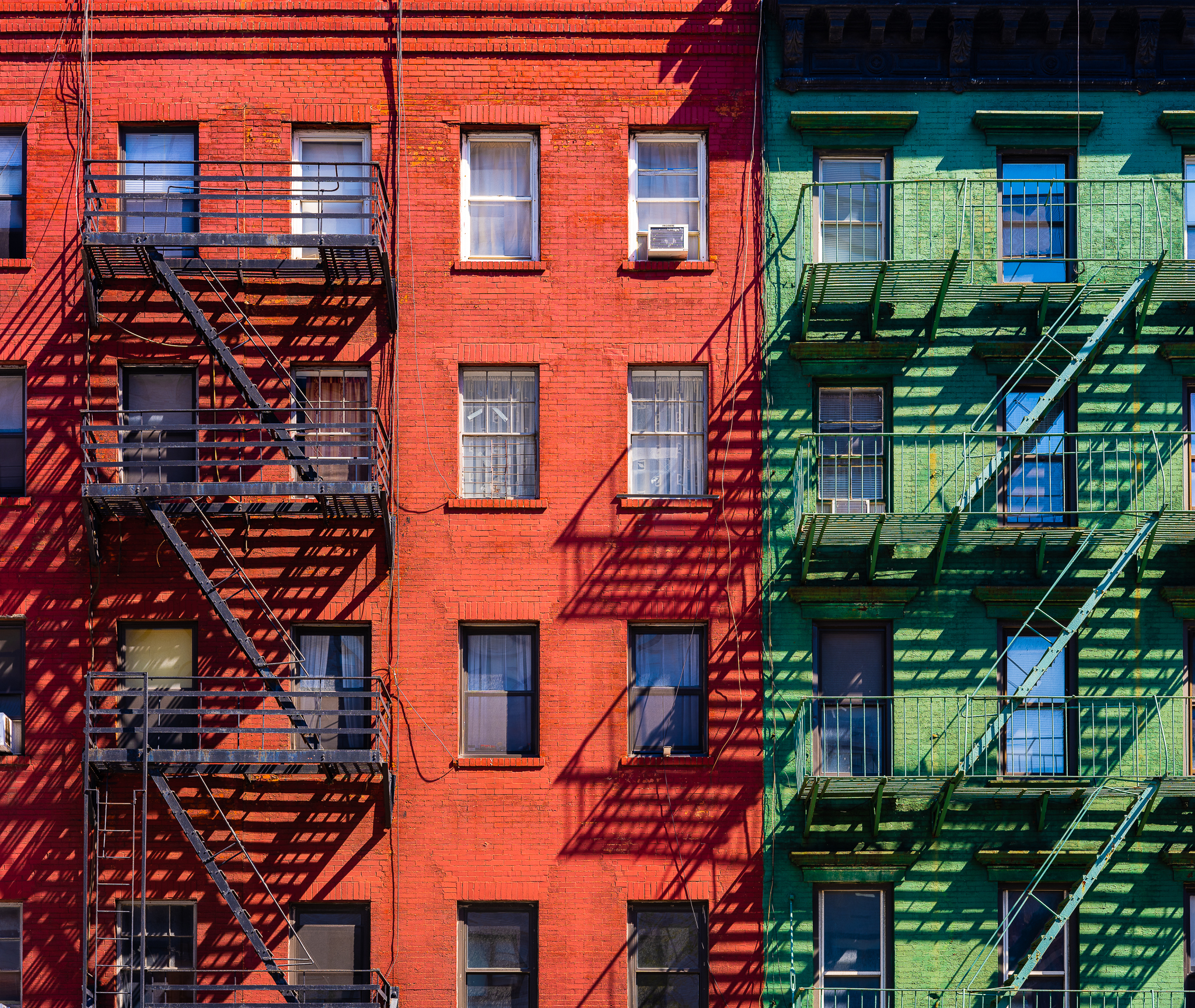a photo of classic new york architecture with fire escapes