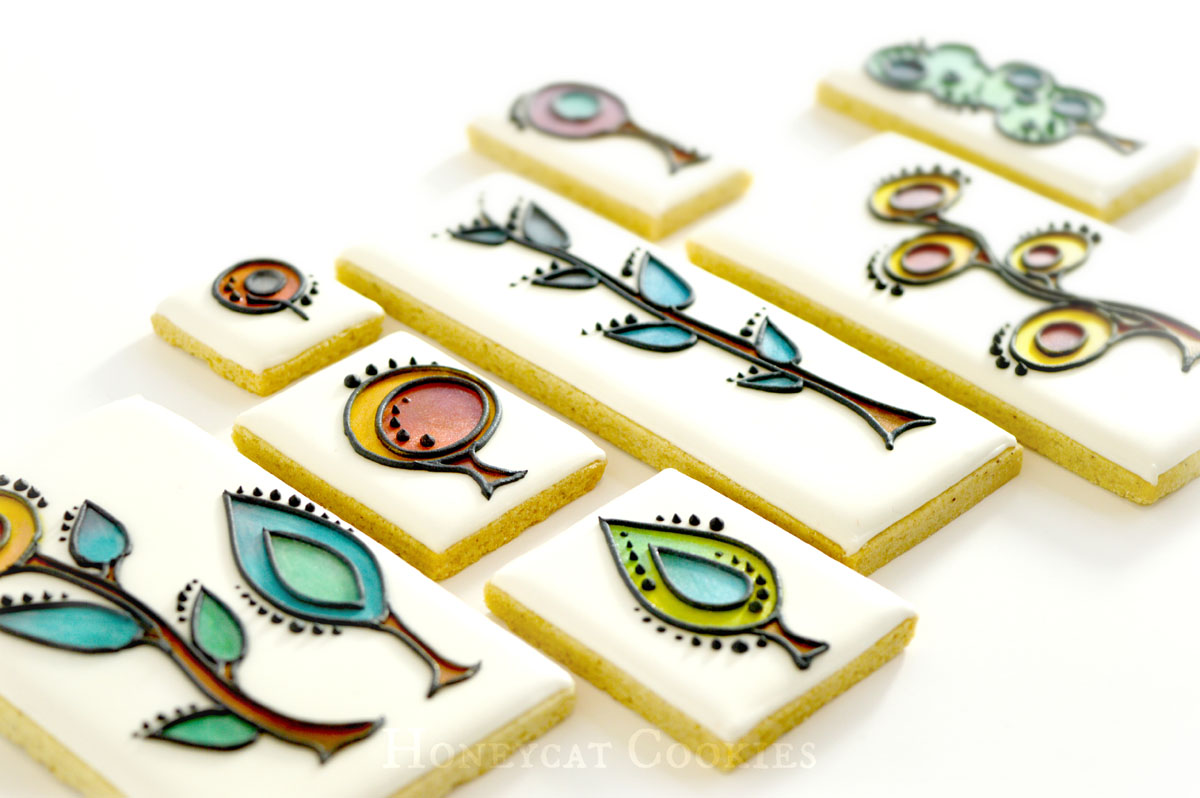 Close up of full set of stylised plant decorated cookies, by Honeycat Cookies