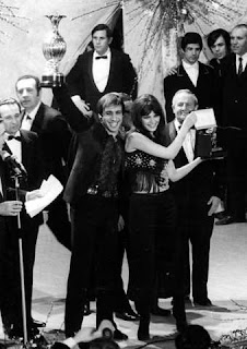 Claudia Mori and Adriano Celentano celebrate their 1970 Sanremo victory
