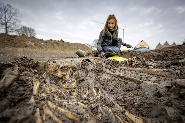 Mass grave containing 20 medieval skeletons discovered in Netherlands moat