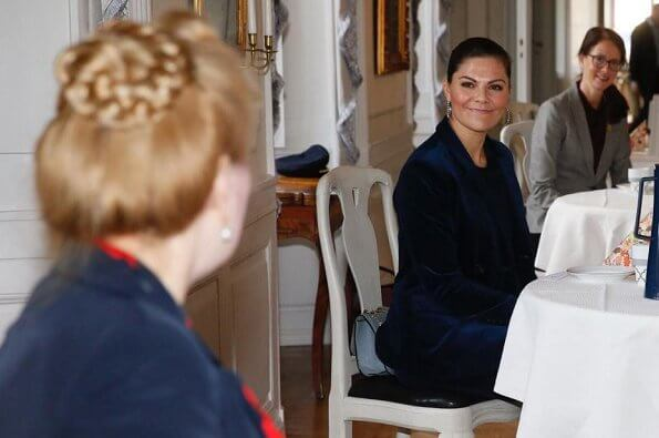 Princess Victoria wore a cord suit by Dagmar, and blue boots by af Klingberg, and pyramid earrings by Sophie by Sophie