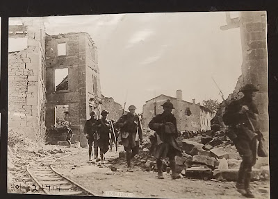 Soldiers Co K 110th Regt in ruins of French town Sept. 1918