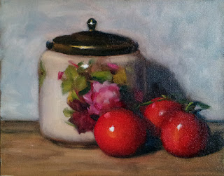 Oil painting of vine-ripened tomatoes beside an antique biscuit barrel with a flower pattern.