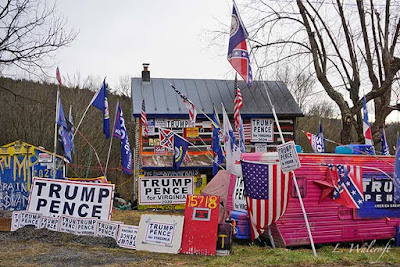 House covered with Trump signs