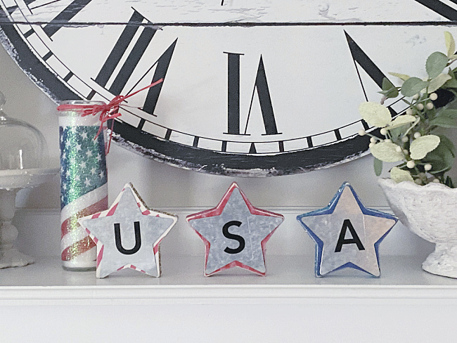 USA stars on a mantel with a clock and candle