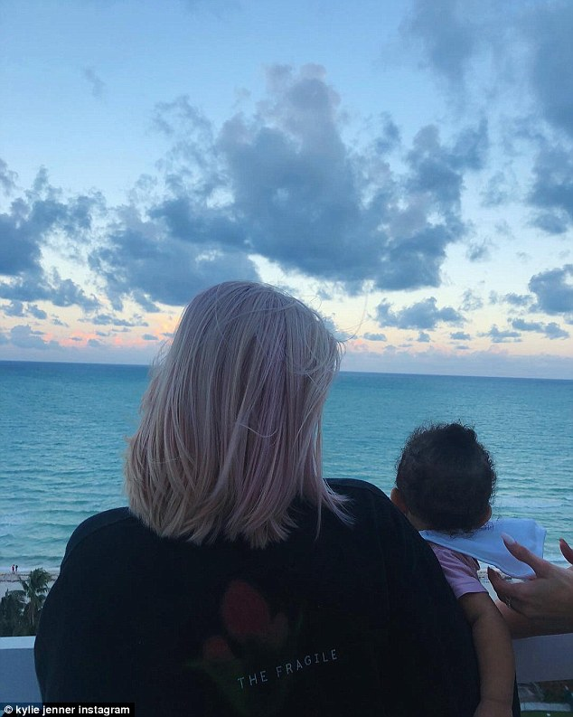 Kylie Jenner flaunts her post-baby body in a skimpy bikini while on a beach vacation in Miami with her daughter Stormi