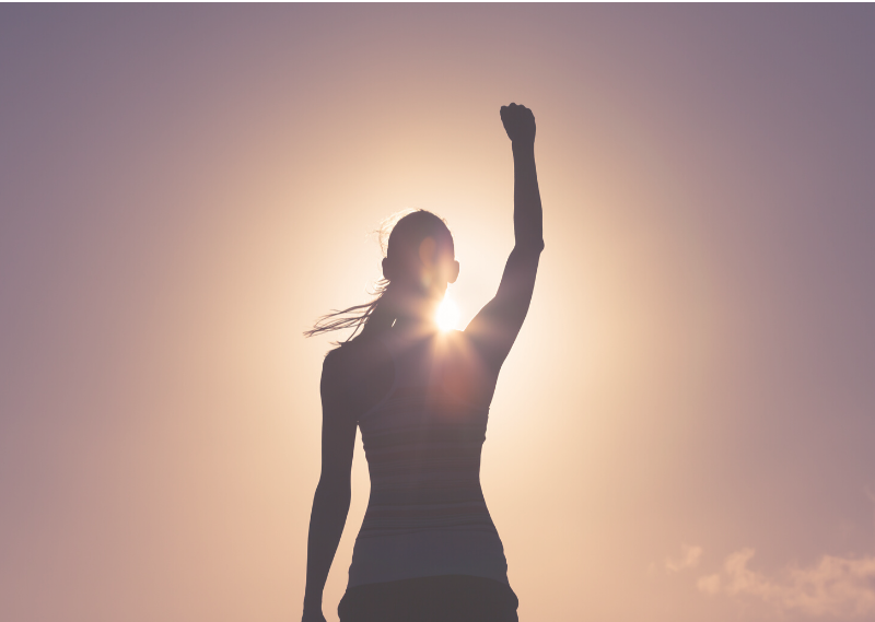 Lady with her arm raised up in a post about 8 simple things you can do to boost your confidence
