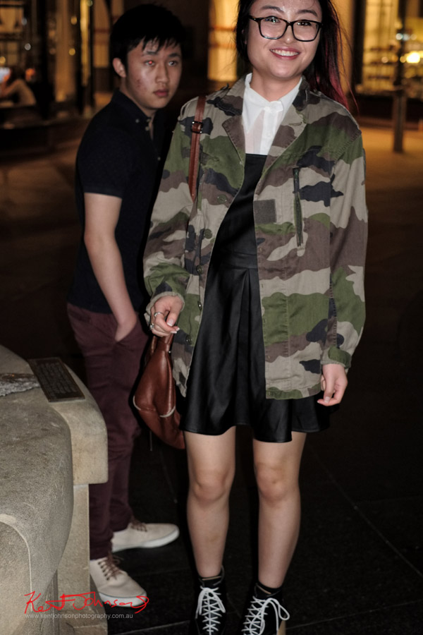 Camouflage jacket over black smock dress and white blouse - QVB at night.