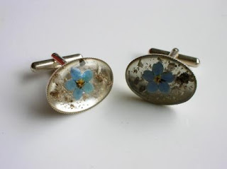 Sterling silver cufflinks containing ashes and a forget me not flower