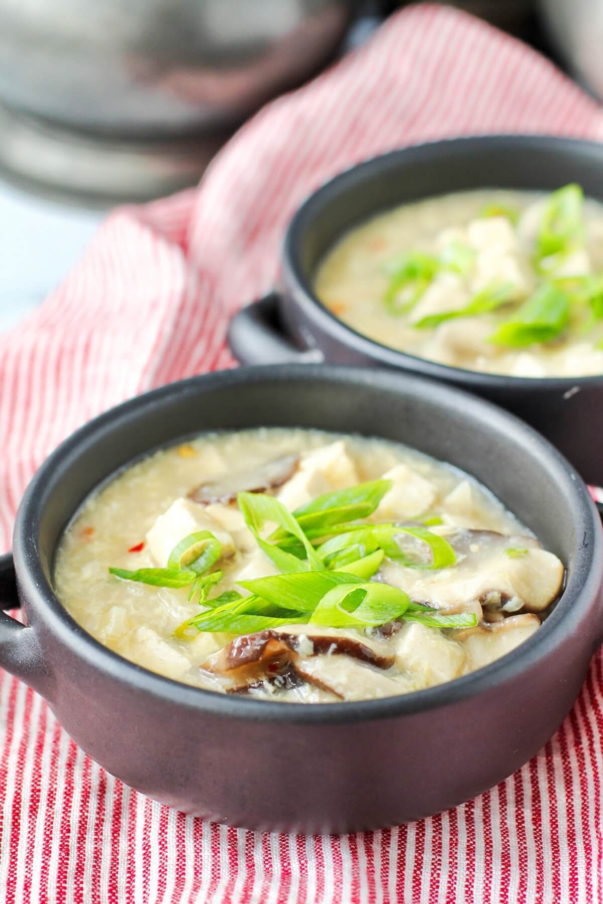 Hot and Sour Egg Drop Soup in bowls with scallions