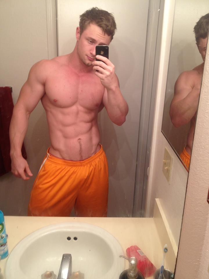 fit-jock-shirtless-body-cocky-hunk-selfie-orange-shorts