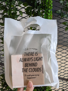 Quote on plastic bag about clouds