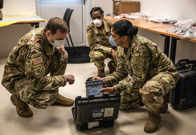 Lt. Col, Preston, Commander of the US Army Health Clinic in Hohenfels, inspects mobile ventilators at the Pete Burke Center on Artillery Barracks in Garmisch-Partenkirchen, Germany, April 15th.