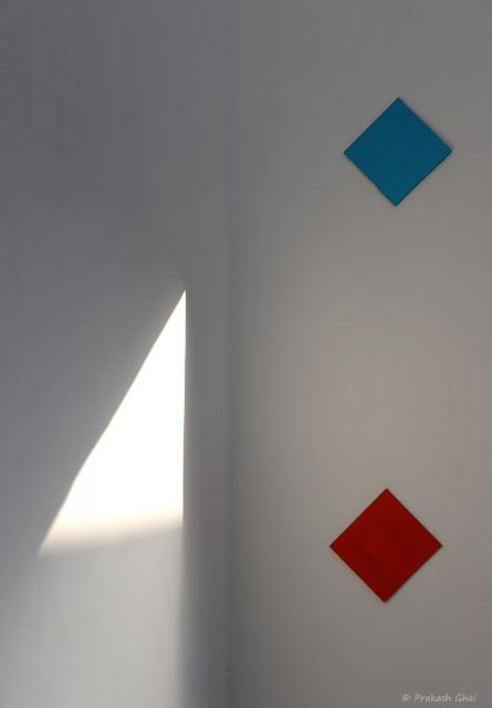 A Minimal Art Photograph of a Colorful Squares Versus a Light Triangle, captured at Jawahar Kala Kendra, Jaipur