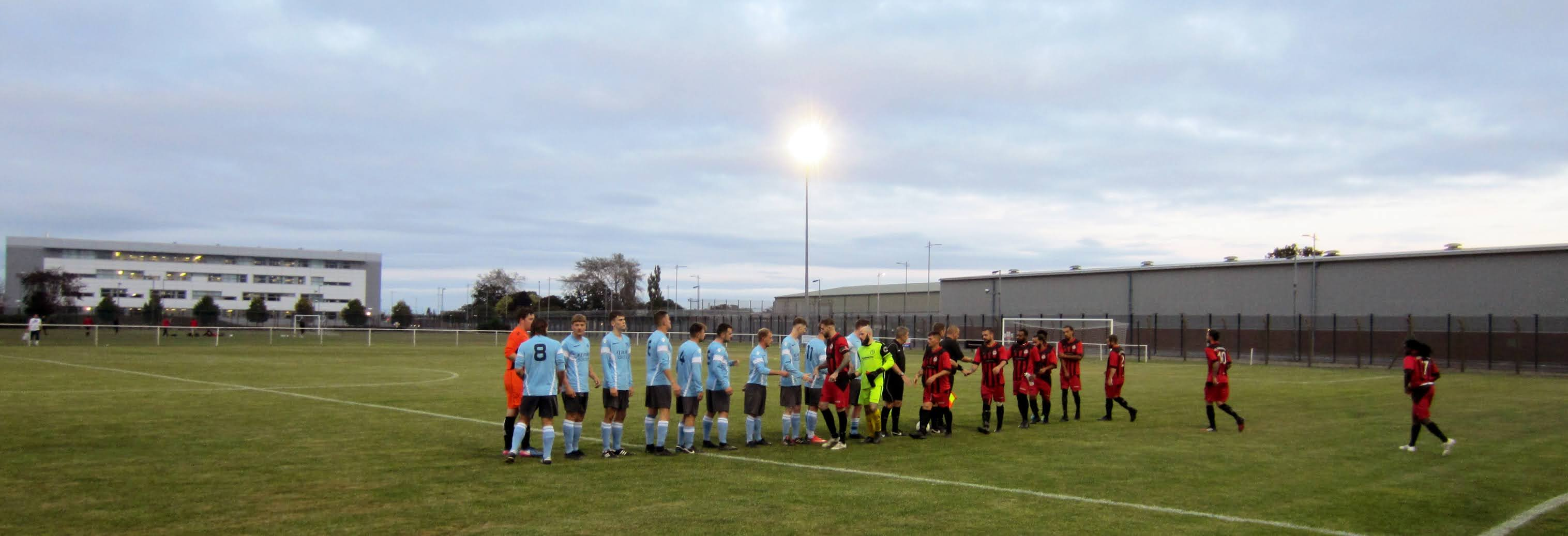 AFC Aldermaston and Woodley United players shake hands before the game