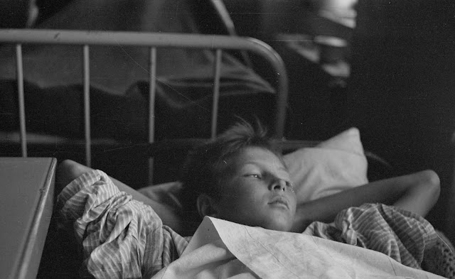 Thirteen-year-old Veikko Rantala lies wounded in Lieksanjoki Military hospital.