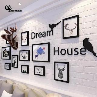 Como fazer uma composição de quadros na parede de sua casa