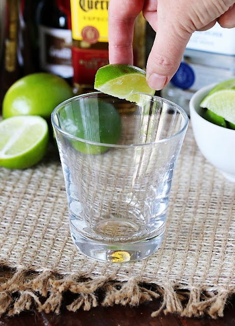 Rubbing Margarita Glass Rim with Lime Image