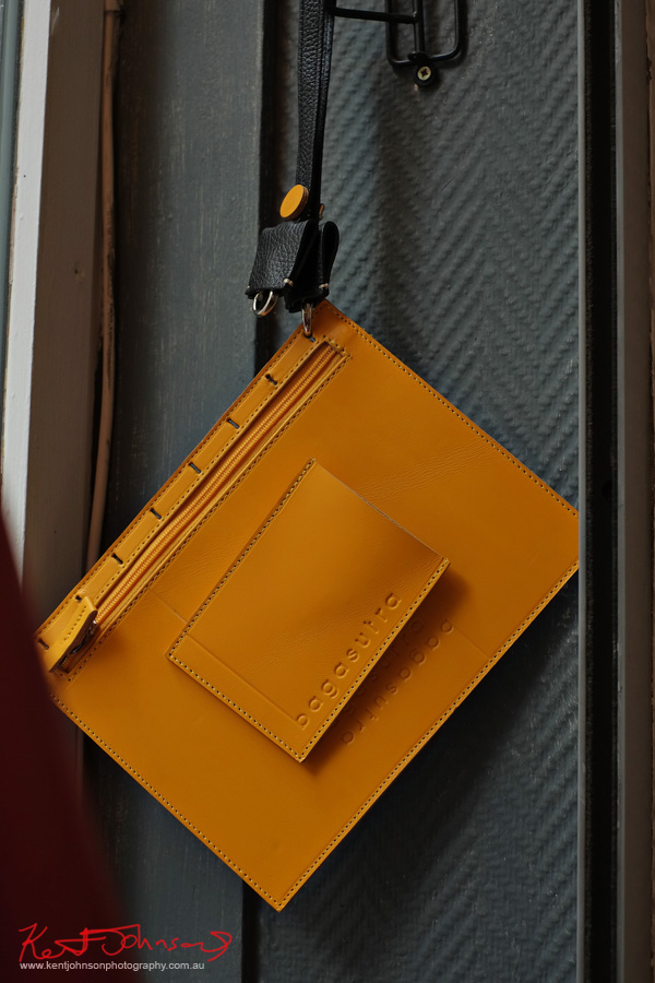 A leather Bagastura hangs in the window of Catherine Loiret on Rue Amélie Paris, France. Photography by Kent Johnson.