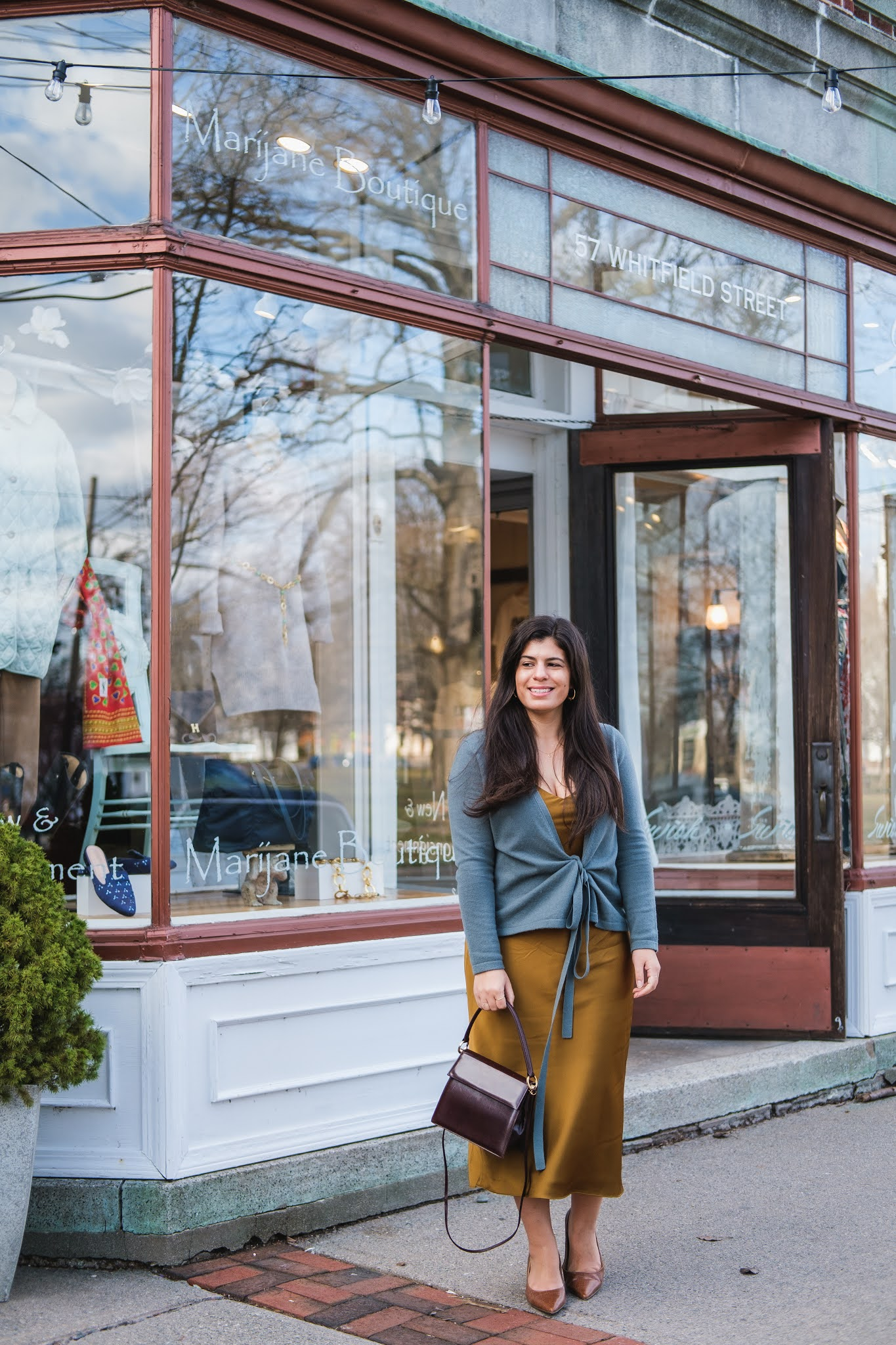 Connecticut style blogger Lydia Abate wearing a satin slip dress, cashmere cardigan, vintage bag, croc heels
