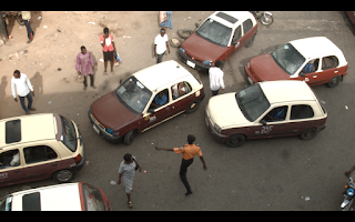 Nigerian men and taxis viewed from above