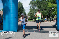 Runners of all ages cross the finish line at the first annual 6 Dot Dash 5K